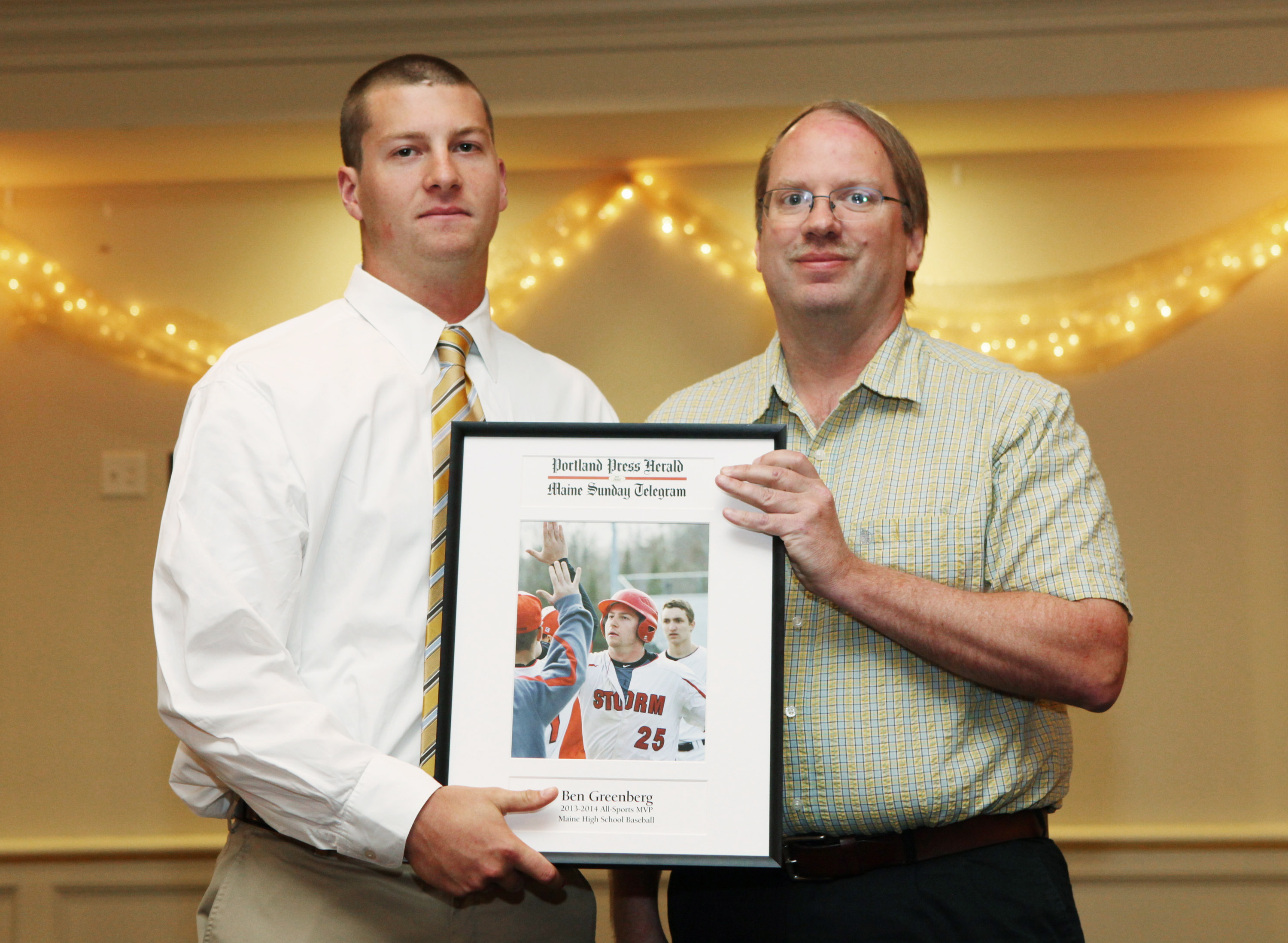 Ben Greenberg of Scarborough High School receives an award for baseball from Press Herald sports writer Mark Emmert during the 27th Annual All-Sports Awards Sunday. Joel Page/Staff Photographer