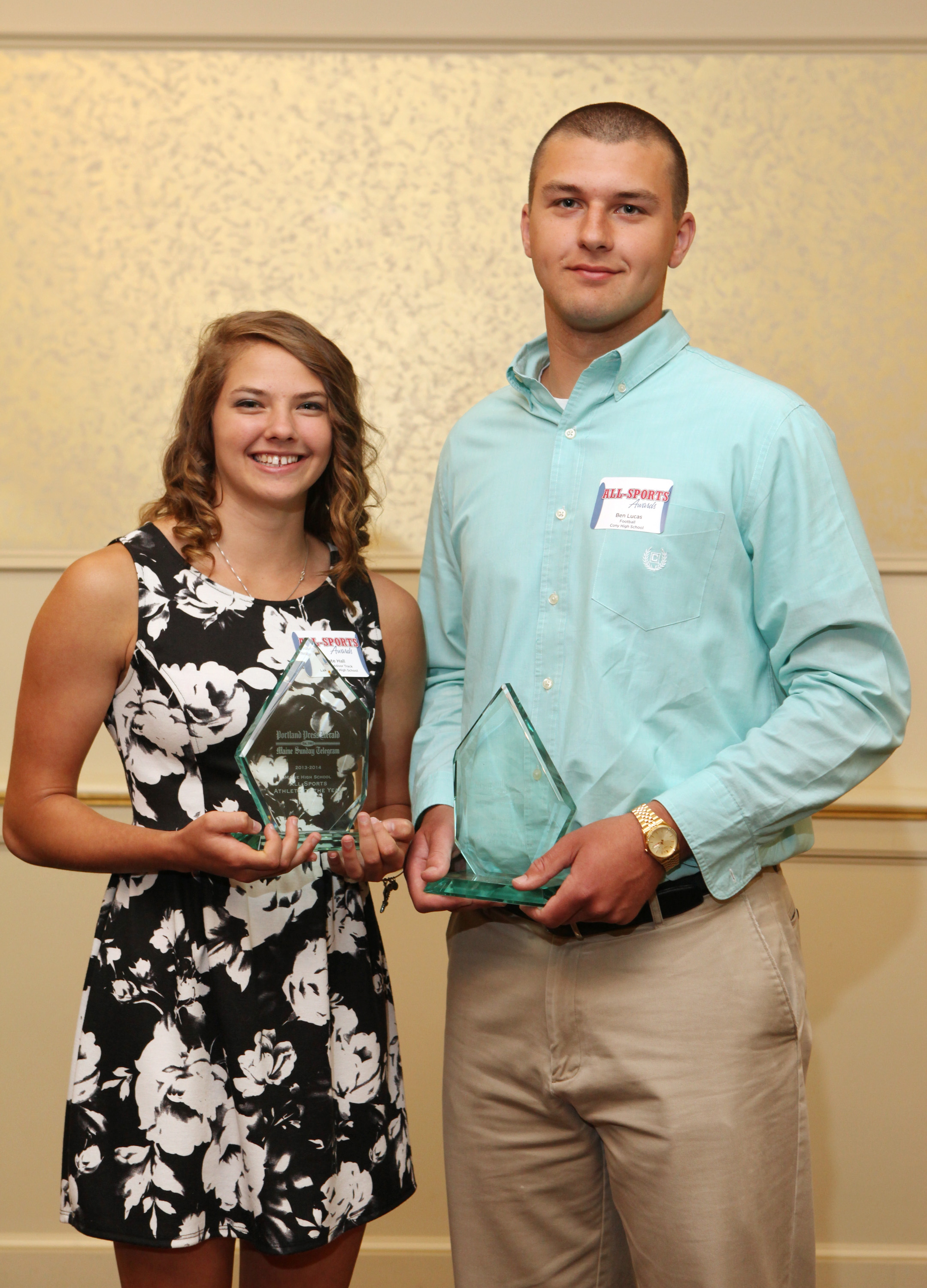 Athletes of the Year Kate Hall of Lake Region High School, and Ben Lucas of Cony High School poses with their awards at the 27th Annual All-Sports Awards ceremony Sunday. Joel Page/Staff Photographer