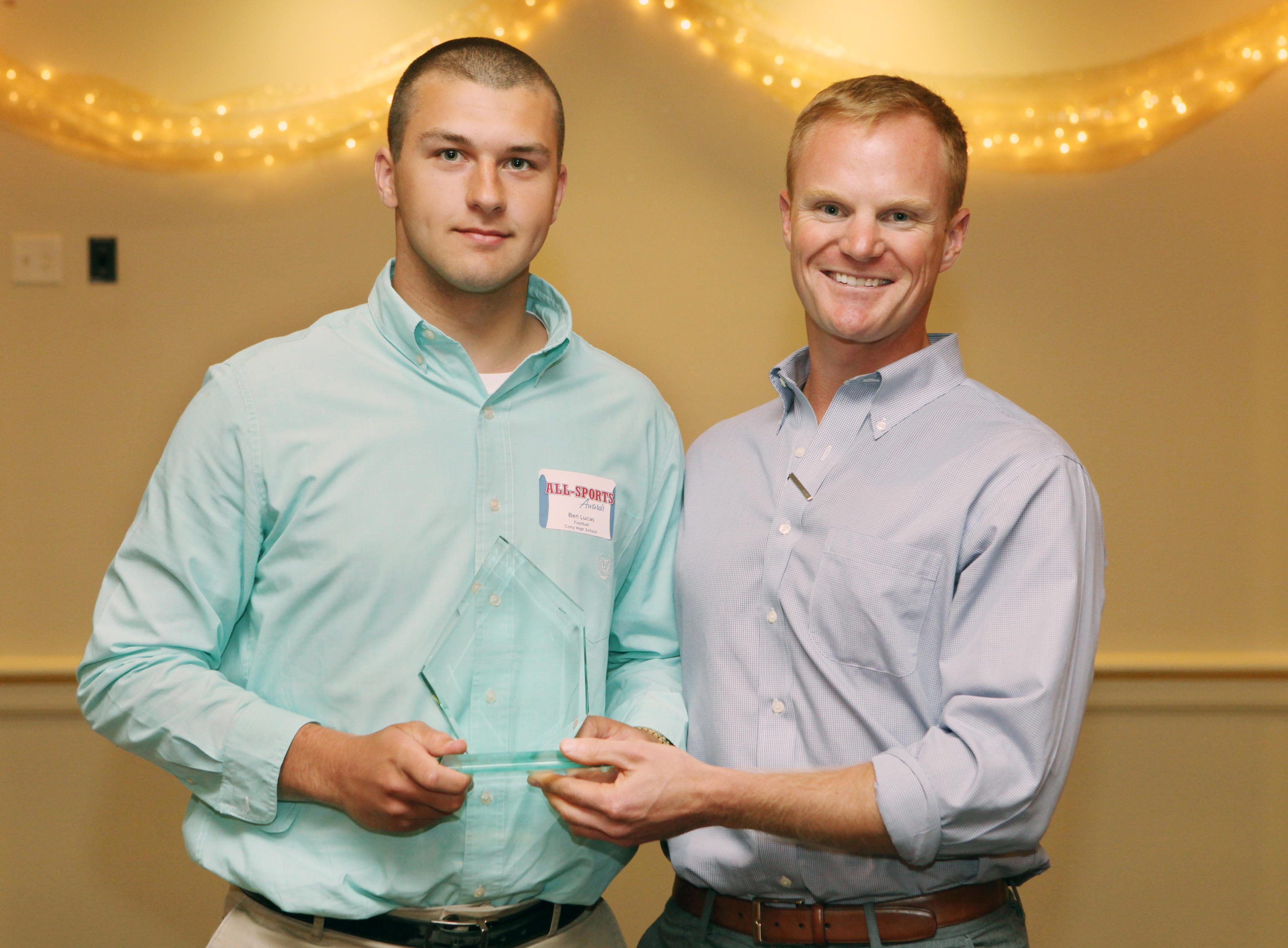 Athletes of the Year Ben Lucas of Cony High School poses with former major league baseball player Simon Williams during at the 27th Annual All-Sports Awards ceremony Sunday. Joel Page/Staff Photographer