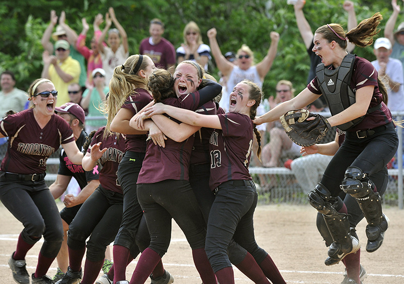 TA players and fans celebrate winning the Western Class A Softball Championship game against Scarborough 2-1 at St. Joseph's College in Standish. John Patriquin/Staff Photographer