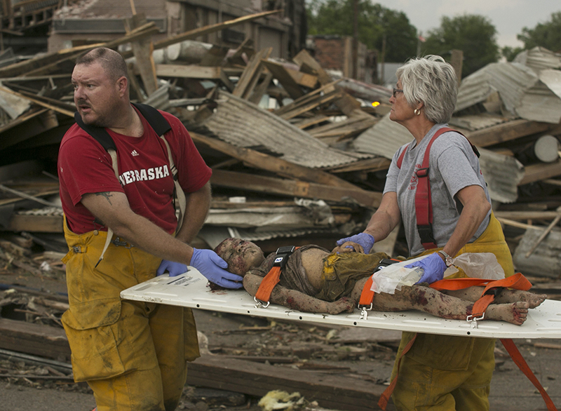 Rescue personnel tend to a young tornado victim in  Pilger, Neb., Monday.