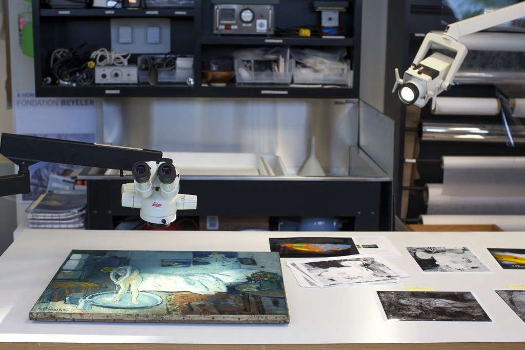 """""""The Blue Room,"""" one of Pablo Picasso's first masterpieces, sits under a microscope at The Phillips Collection on June 10 in Washington. The Associated Press"""