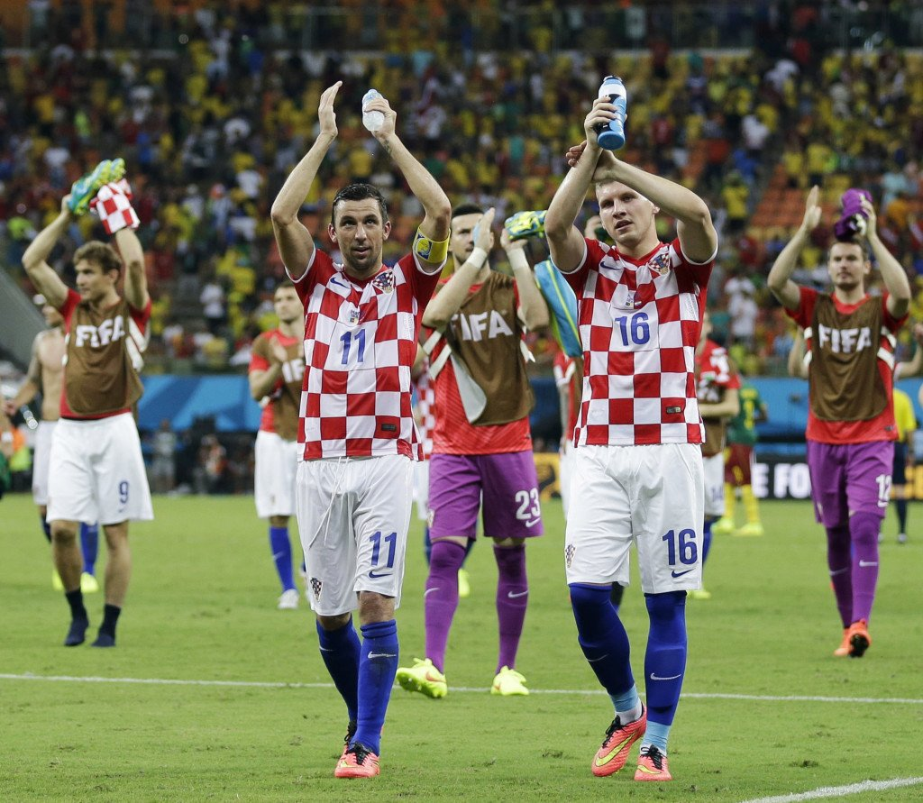 Croatian players applaud their supporters following their 4-0 victory over Cameroon during the group A World Cup soccer match at the Arena da Amazonia in Manaus, Brazil, Wednesday, June 18, 2014.