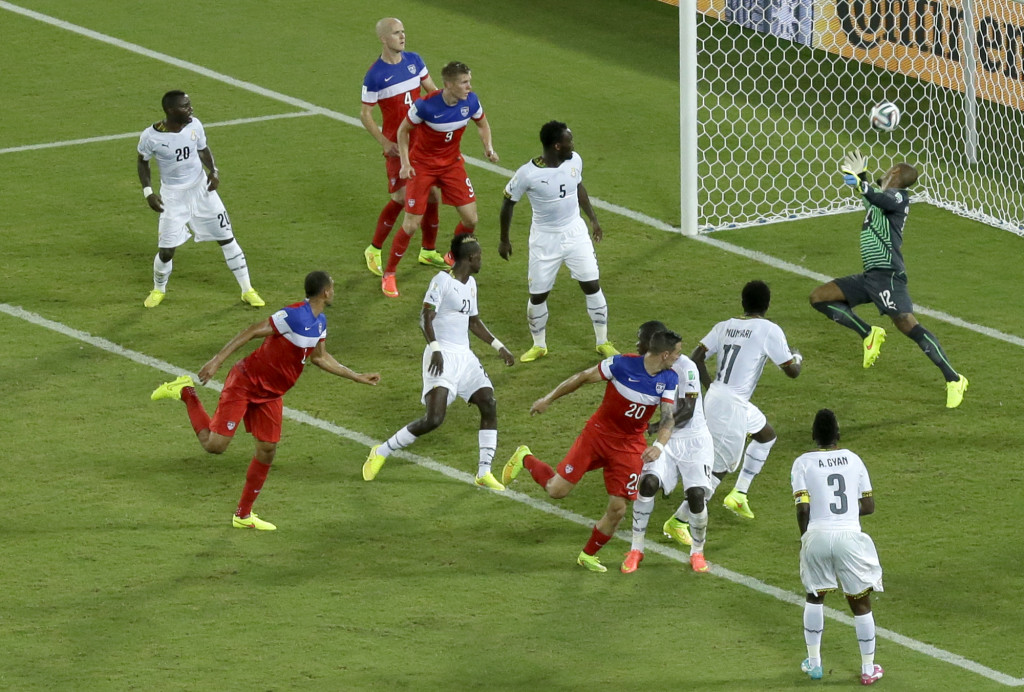 United States' John Brooks, second from left, scores his side's second goal during the group G World Cup soccer match between Ghana and the United States. The U.S. defeated Ghana 2-1.