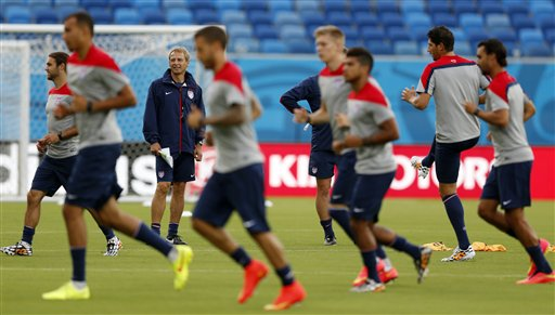 The United States soccer team warms up during an official training session Sunday, the day before the group G World Cup soccer match between Ghana and the United States at the Arena das Dunas in Natal, Brazil. The Associated Press