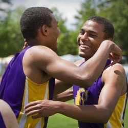 Elijah Yeboah, left, and his brother, Isaac, celebrate their team's victory in the 400 relay. Cheverus' time of 43.32 broke a 7-year-old Class A record, and the Stags went on to capture their first team championship since 1998. Carl D. Walsh/Staff Photographer