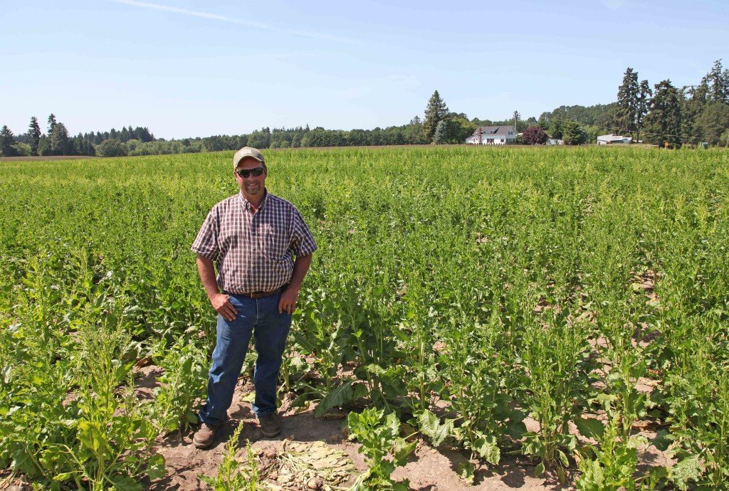"Robert Purdy stands in his field of genetically engineered sugar beets June 6 near Salem, Ore. ""More mapping would be redundant; we're already doing it internally, we all work together with other farmers,"" he said. The Associated Press"