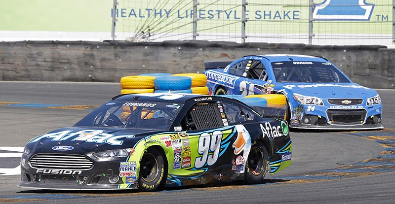 Carl Edwards (99) leads Jeff Gordon in the final laps during the NASCAR Sprint Cup Series auto race Sunday, June 22, 2014, in Sonoma, Calif. Edwards won the race and Gordon finished second. The Associated Press
