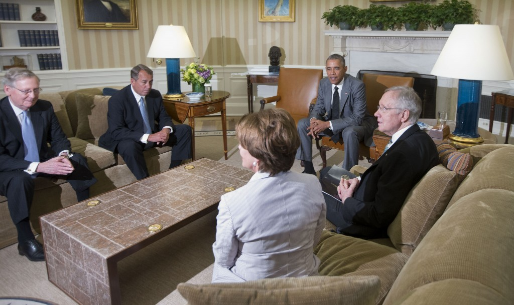 President Barack Obama meets with, from left, Senate Minority Leader Mitch McConnell of Kentucky, House Speaker John Boehner of Ohio, House Minority Leader Nancy Pelosi of California, and Senate Majority Leader Harry Reid of Nevada in the Oval Office of the White House Wednesday. Obama briefed leaders of Congress on U.S. options for blunting an Islamic insurgency in Iraq.