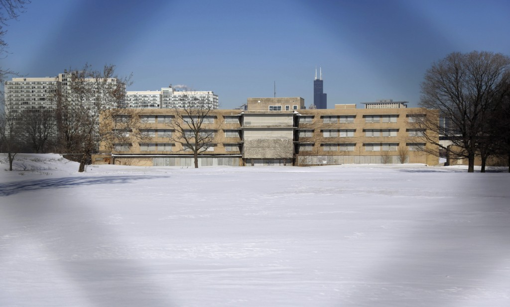 This Feb. 7, 2014,  photo, shows a view  through a fence of the campus that once housed  Michael Reese Hospital in the South Side neighborhood of Bronzeville in Chicago. The site in the city's historic center of black culture, business and politics, is bidding to be the location for a Barack Obama presidential library.