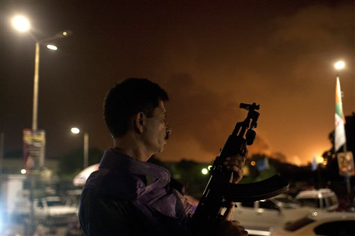 A Pakistani soldier takes position at Jinnah International Airport  where security forces fought Taliban gunmen who disguised themselves as police guards and stormed a terminal used for VIPs and cargo on June 8, 2014.