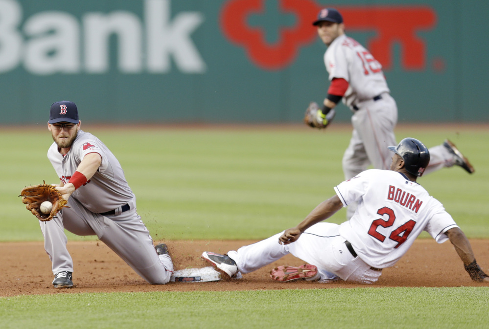 Cleveland Indians' Michael Bourn, right,  steals to second base as Boston Red Sox's Stephen Drew, left, waits for the throw in the first inning of a baseball game, Monday, June 2, 2014, in Cleveland. Bourn was safe on the steal. (AP Photo/Tony Dejak)