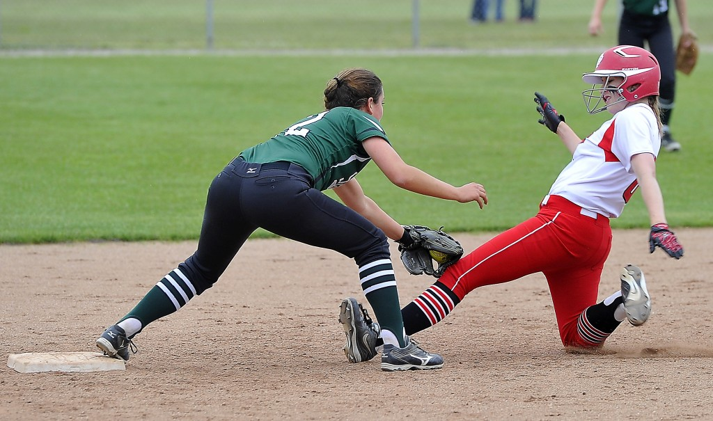 Bonny Eagle shortstop Breanna Lifland tags out South Portland's Michaela Willwerth, who tried to stretch a single into a double during Thursday's playoff game won by Bonny Eagle. Gordon Chibroski/Staff Photographer