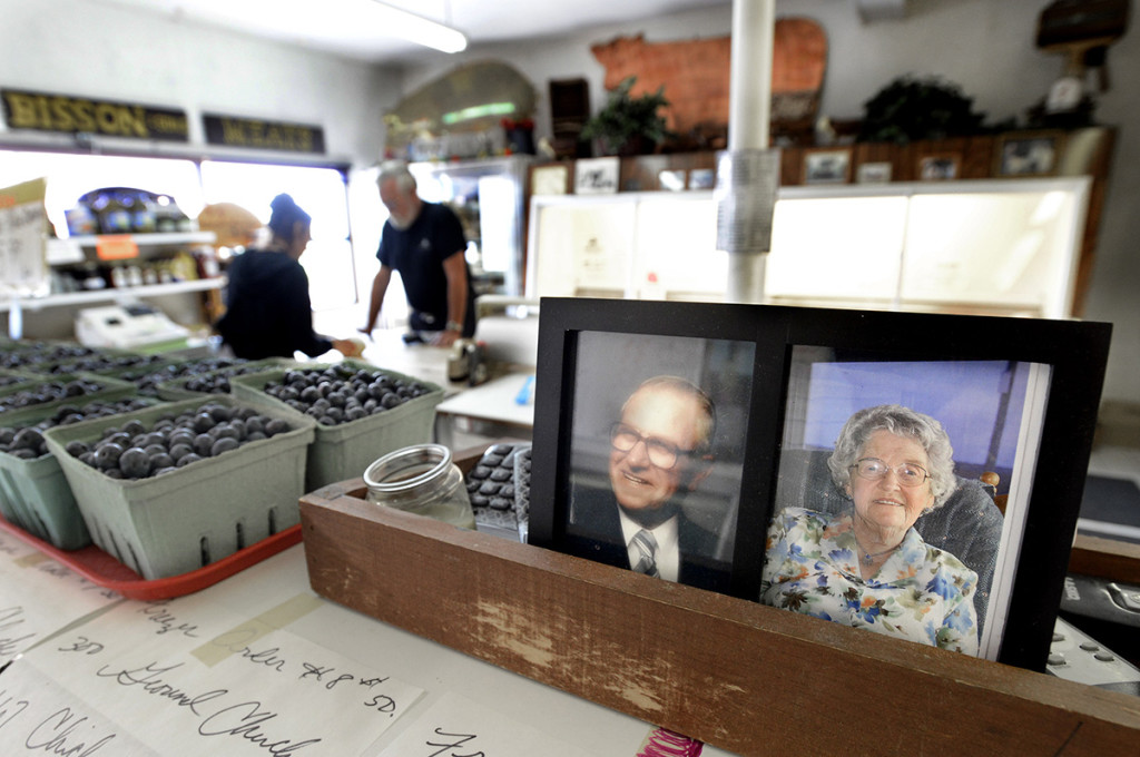 Photos of second generation farmers Paul and Lorraine Bisson are proudly displayed inside the family store.