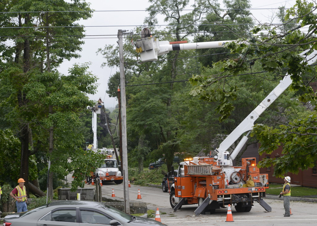A Central Maine Power Company crew works Wednesday to restore power along Lindsay Road after severe storms did major damage in York the night before.