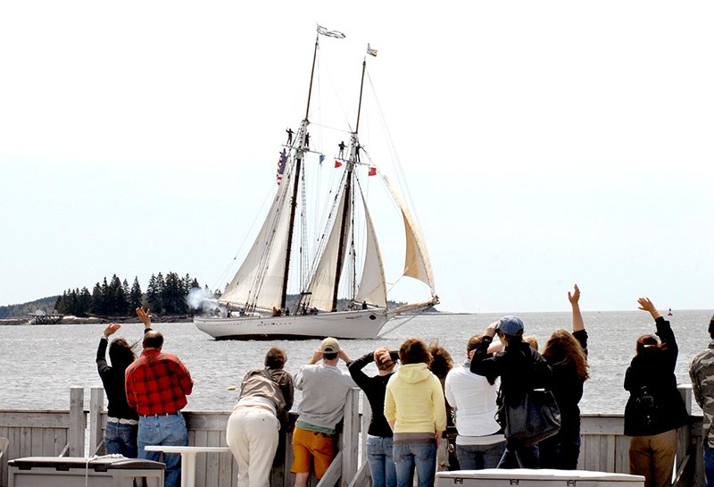 In this 2008 file photo, family and friends wave to the The Spirit of Massachusetts as it returns today to Boothbay Harbor with 17 students that are with the Ocean Classrooms program. John Patriquin/ Staff Photographer