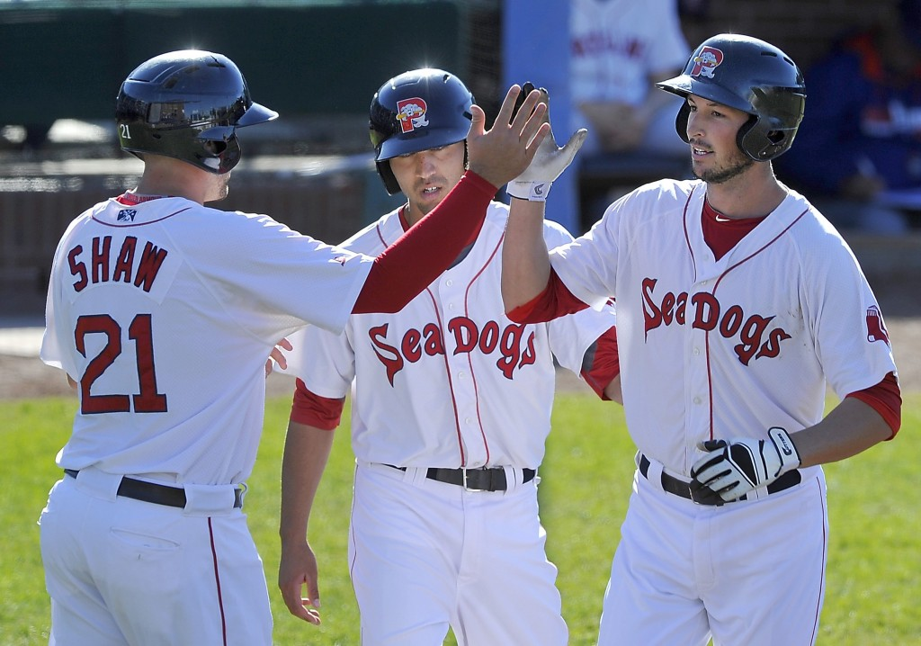 Portland Sea Dog Stefan Welch is greeted by base runners Travis Shaw and Derrik Gibson after hitting a three-run homer at Hadlock Field in May. 2014 Press Herald file
