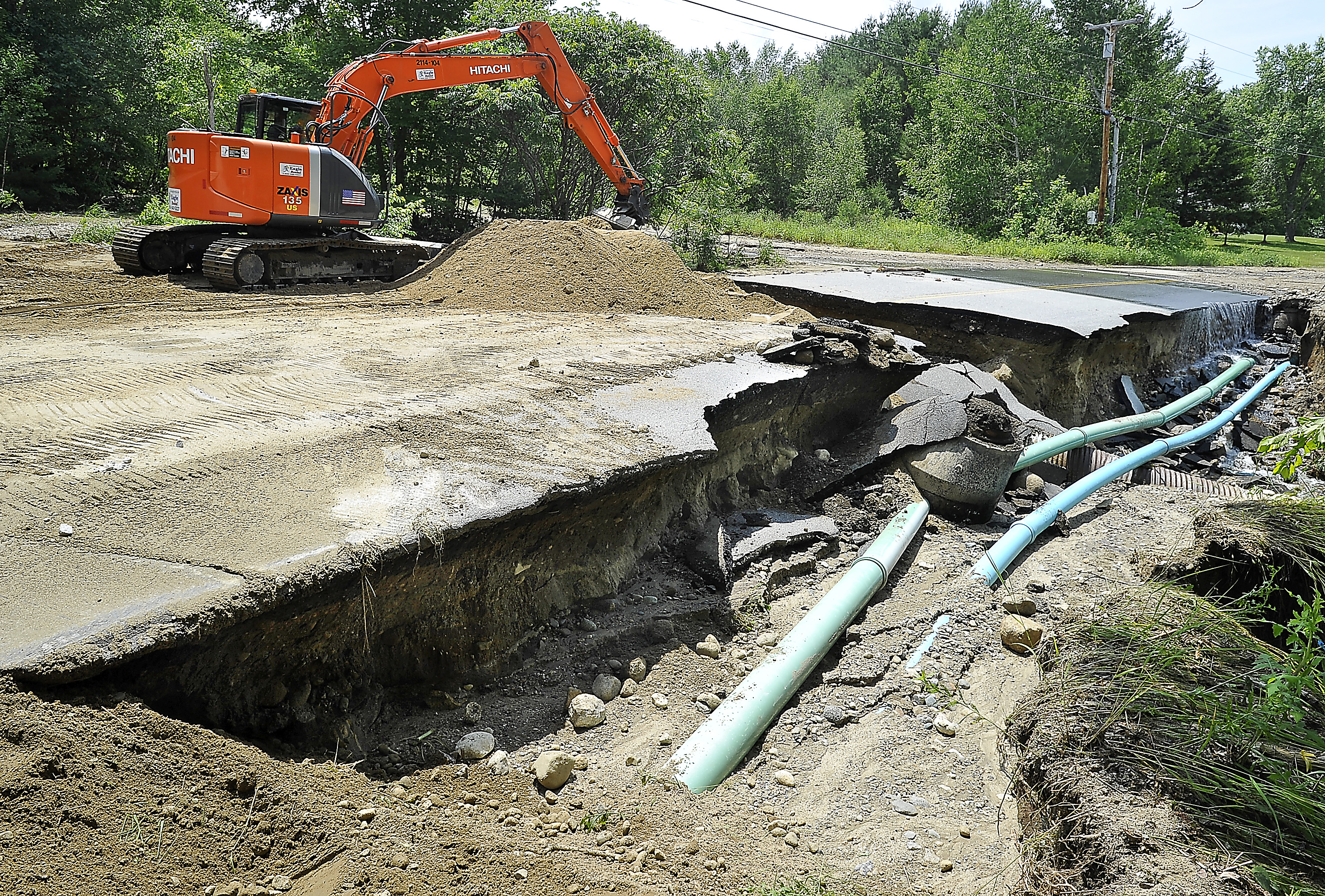 The Maine Department of Transportation makes temporary repairs of washed-out South Rumford Road in Rumford on Thursday after it was damaged by flood waters the night before.