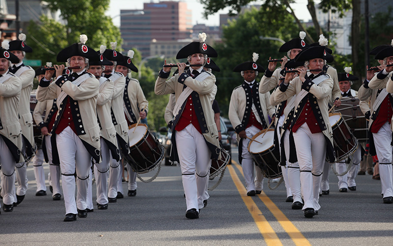 Members of the Middlesex County Volunteers Fifes and Drums march up Congress Street Saturday, July 5, 2014 heading for July 4th celebration on the Eastern Promenade in Portland, Maine. The fireworks were postponed a day due to weather. Joel Page/Staff Photographer