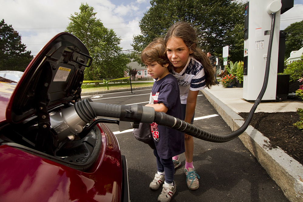 Luis Frederick Robinson, 4, and his sister Kerry-Elizabeth, 8, watch an electric car get quick-charged in South Portland. Carl D. Walsh/Staff Photographer