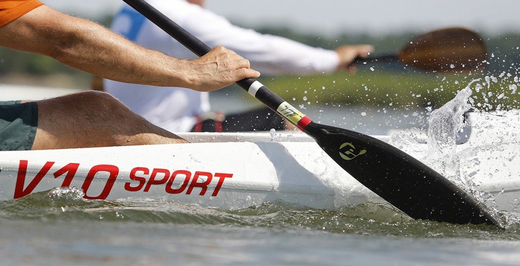 A paddler cuts through the water during a surf ski kayak lesson with 12-time World Champion surf ski kayak racer Oscar Chalupsky.