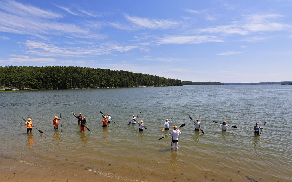 Oscar Chalupsky, 12-time World Champion surf ski kayak racer from South Africa, works with paddlers at Thomas Point Beach.