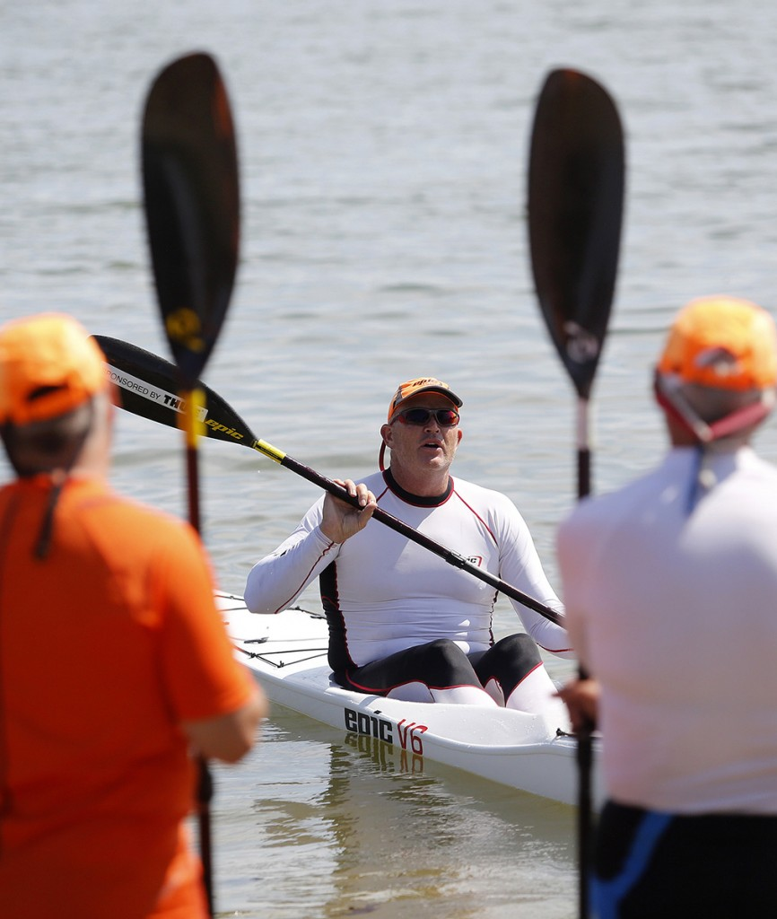 Paddling enthusiasts listen to South African Oscar Chalupsky during a surf ski kayak lesson.