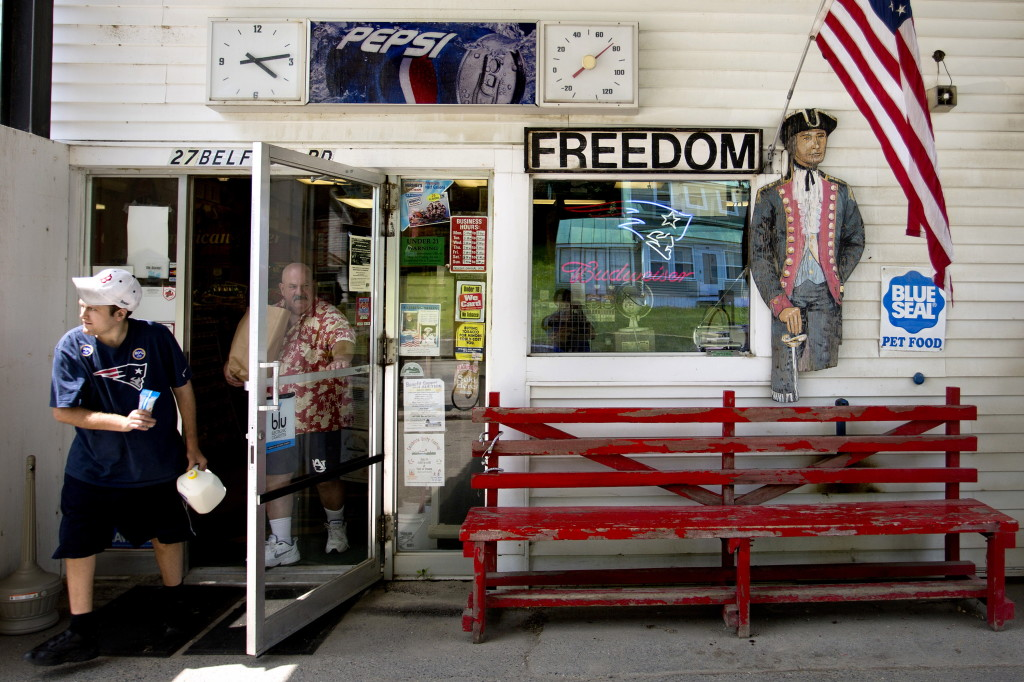 """Customers leave the Freedom General Store in Freedom on the afternoon of Monday, June 30, 2014. The store is known as the """"hang out"""" in town, and proudly displays its patriotism, from the cardboard cutout of a soldier to the American flag at right."""
