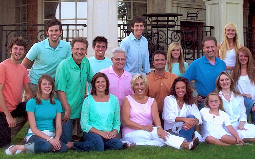 Members of the Green family that run Oklahoma-based Hobby Lobby pose outside the home of David , middle row third from left, and Barbara, front row, third from left, in 2006. Mart Green, who rescued Oral Roberts University, is just left of his father; Steve Green is in the same row at the far right. The Supreme Court ruled 5-4 Monday that requiring closely-held companies to pay for some methods of contraception violates religious freedom.