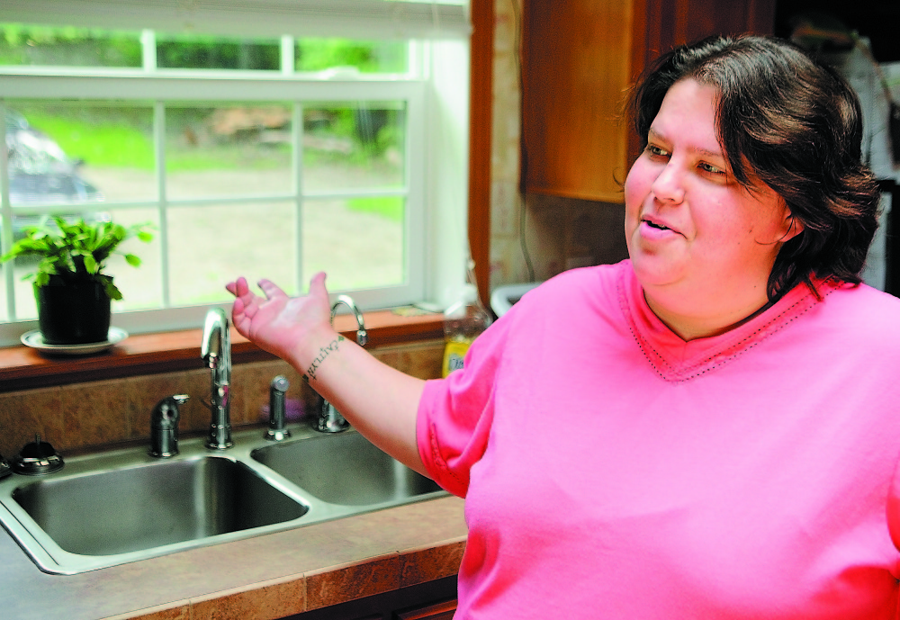 Wendy Brennan talks in 2011 about the reverse-osmosis arsenic filtration system in her Mount Vernon home. Brennan, whose two daughters and two grandchildren live with her, had the filtration system installed after a study found arsenic levels in her well water that were more than five times the federal standard.