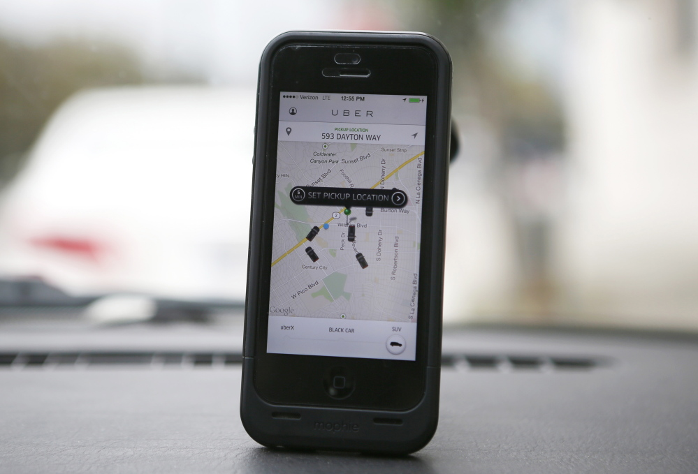 An Uber app is seen on an iPhone in Beverly Hills, California, December 19, 2013. Uber has entered more than 60 markets, ranging from its hometown of San Francisco to Berlin to Tokyo. Leaked financials in December indicate that the company, which began connecting passengers with drivers of vehicles for hire about 3-  years ago, is generating $200 million a year in revenue beyond what it pays to drivers. Photo taken December 19, 2013.  REUTERS/Lucy Nicholson (UNITED STATES - Tags: BUSINESS TRANSPORT) - RTX1705H