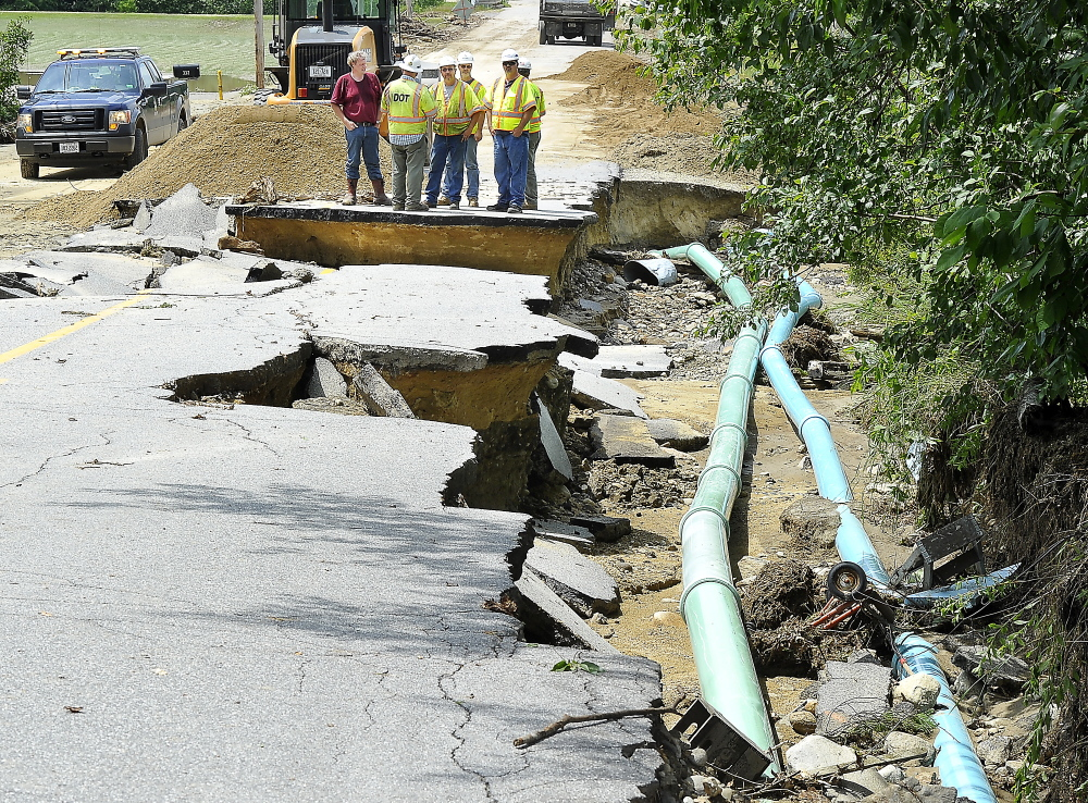 Maine Department of Transportation employees on Thursday inspect the damage caused by Wednesday night's severe weather at South Rumford Road in Rumford.