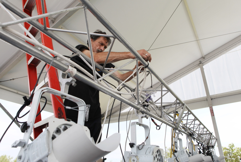 "Bill Brown works Thursday on wiring the stage lights for Portland's Fourth of July celebration, now scheduled for Saturday. The Portland Symphony Orchestra's ""Patriotic Pops"" performance begins at 7:40 p.m. and the fireworks at 9:20 p.m."
