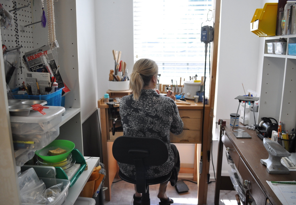 "Amanda Carroll runs her online business from her home studio in Concord, N.C. ""My store schedule was 24/7. Nine a.m. to 8 p.m. was my day at the store. Here, I just have a nicer routine. I include regular breaks from being hunched over something. I make time to meditate,"" she says."