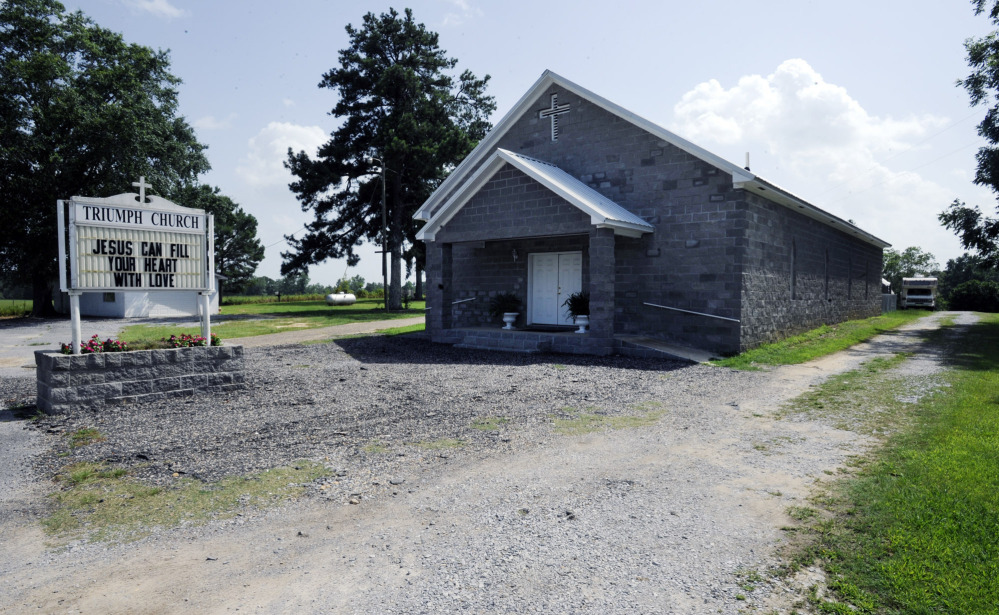A gravel drive leads to a camp where convicted sex offenders lived behind Triumph Church near Clanton, Ala. A law that took effect Tuesday closed the refuge, which Pastor Ricky Martin says he founded to follow the Bible's instructions to care for the outcast.
