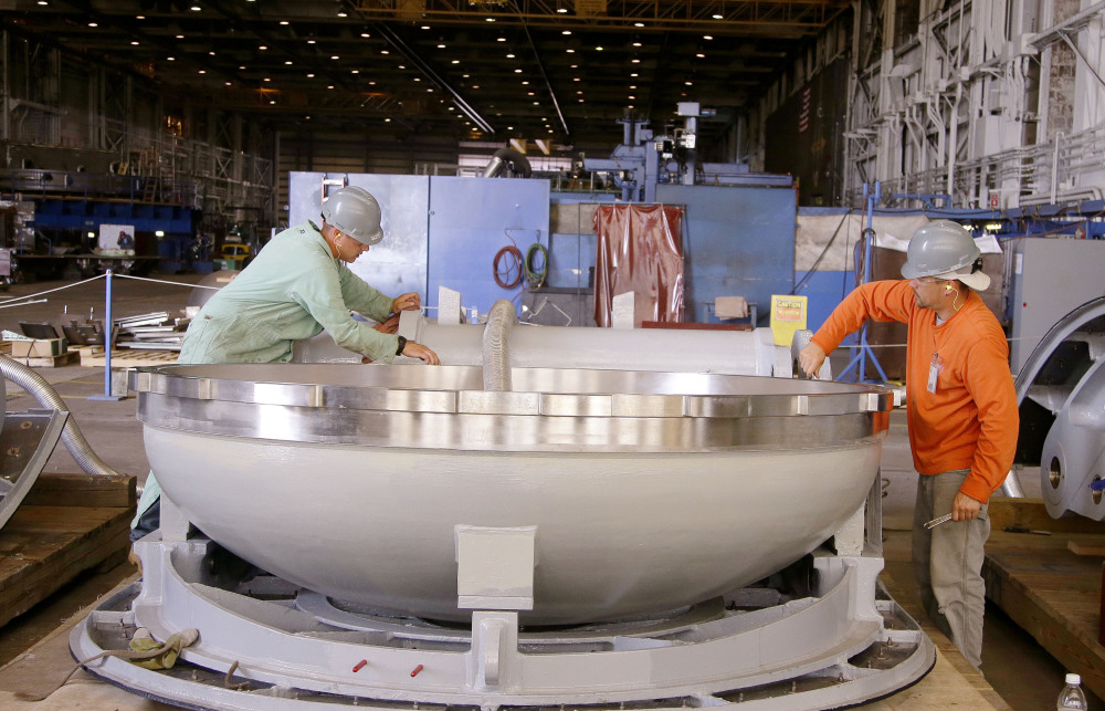 Employees from Electric Boat inspect a missile hatch for a Virginia-class nuclear-powered submarine at the company's Quonset Point facility in North Kingstown, R.I. News of a pending Navy contract is welcome in the state with the nation's highest unemployment rate. While shipyard officials say they want to hire Rhode Island residents to fill positions, however, it has been challenging to find people with the necessary skills.