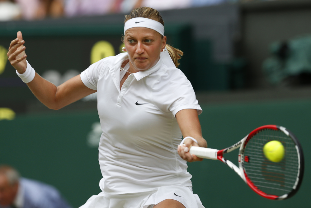 Petra Kvitova returns a shot to Eugenie Bouchard the women's singles final at Wimbledon on Saturday.