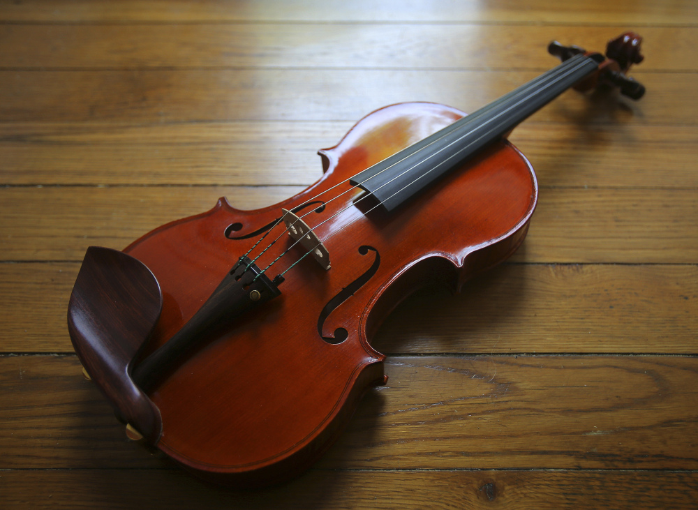 "Clancy went from not being able to ""sharpen a pencil,"" her father says lovingly, to crafting violins, including this one."