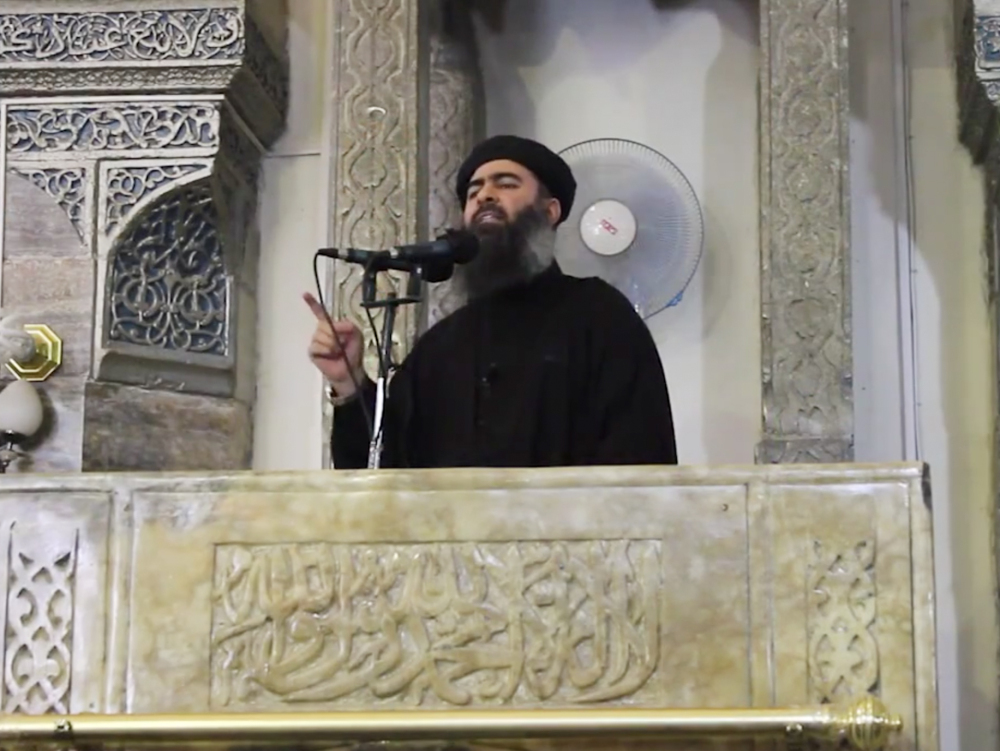 This image made from video posted on a militant website Saturday, which has been authenticated based on its contents and other AP reporting, purports to show the leader of the Islamic State group, Abu Bakr al-Baghdadi, delivering a sermon at a mosque in Iraq. The Associated Press