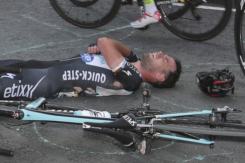 Britain's sprinter Mark Cavendish grimaces after he crashed late in the first stage of the Tour de France on Saturday. Cavendish pulled out of the race Sunday with an injured shoulder that may require surgery.