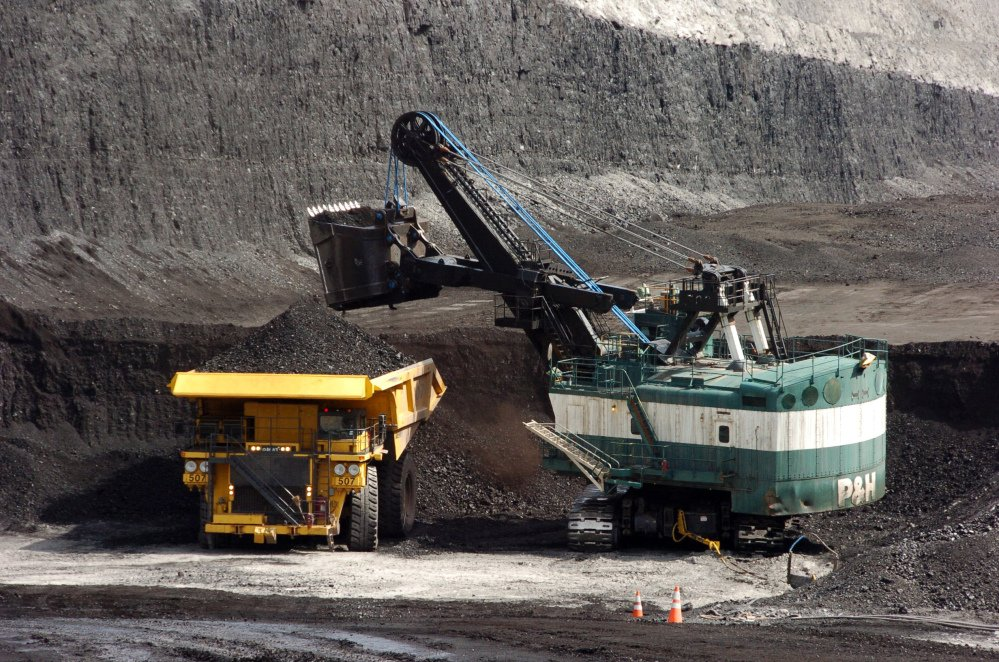 A mechanized shovel loads coal onto a haul truck at the Cloud Peak Energy's Spring Creek mine near Decker, Mont. Coal industry representatives say lawsuits against mines in the West could have consequences across the U.S. as environmentalists seek changes in how mining is approved on federally-owned reserves.