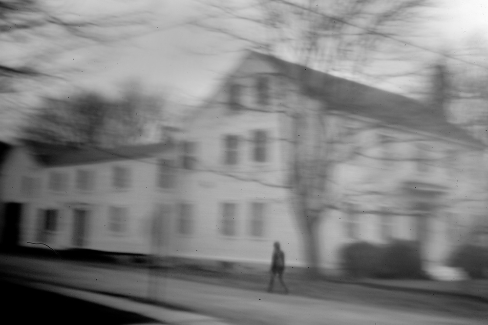 "A woman walks past the Eastport house that Don Gellers called home when he represented the Passamaquoddys in the 1960s. Gellers was arrested here in 1968, right after filing a $150 million land claims suit for the tribe, on charges of ""constructive possession"" of marijuana cigarettes."
