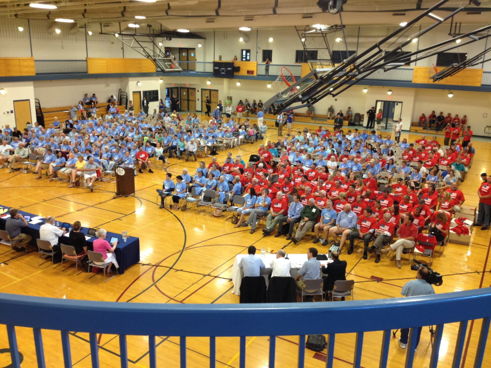 A large crowd, many wearing colored T-shirts, attends Wednesday's City Council meeting in the South Portland Community Center gym.