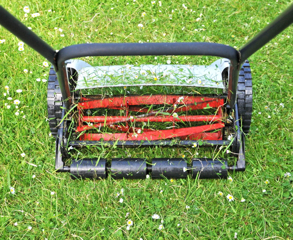You won't pollute the soil or air with a manual reel lawnmower. An electric mower is another, though less green, option.