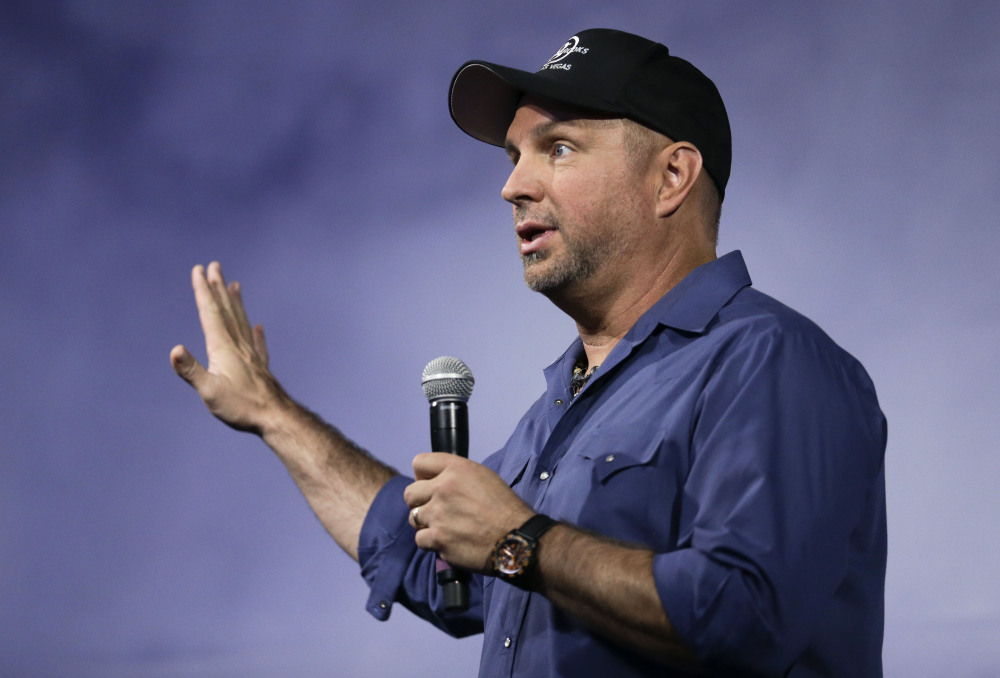 "Country music star Garth Brooks speaks at a news conference on Thursday in Nashville. ""If the prime minister himself wants to talk to me I will crawl, swim, I will fly over there this weekend, sit in front of him."" he says."