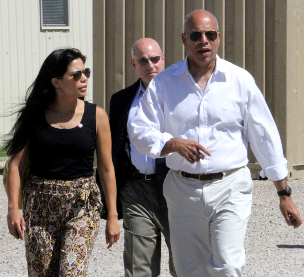 "Department of Homeland Security director Jeh Johnson walks to a podium after finishing a tour of the Residential Detention Facility inside the Federal Law Enforcement Training Center in Artesia, N.M. on Friday, July 11, 2014. Johnson visited the facility housing 400 Central American women and children and warned immigrants that ""we will send you back"" if they try crossing into the country. (AP Photo/Pool, El Paso Times, Rudy Gutierrez)"