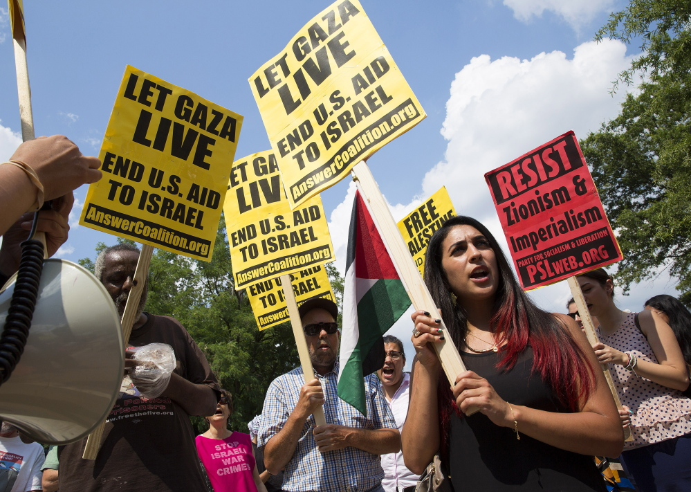 Protesters call for an end to the Israeli airstrikes on Gaza during a demonstration Friday in front of the Israeli Embassy in Washington. More than 100 Palestinians have been killed, including dozens of civilians, in the four-day operation to halt rocket attacks by Hamas.