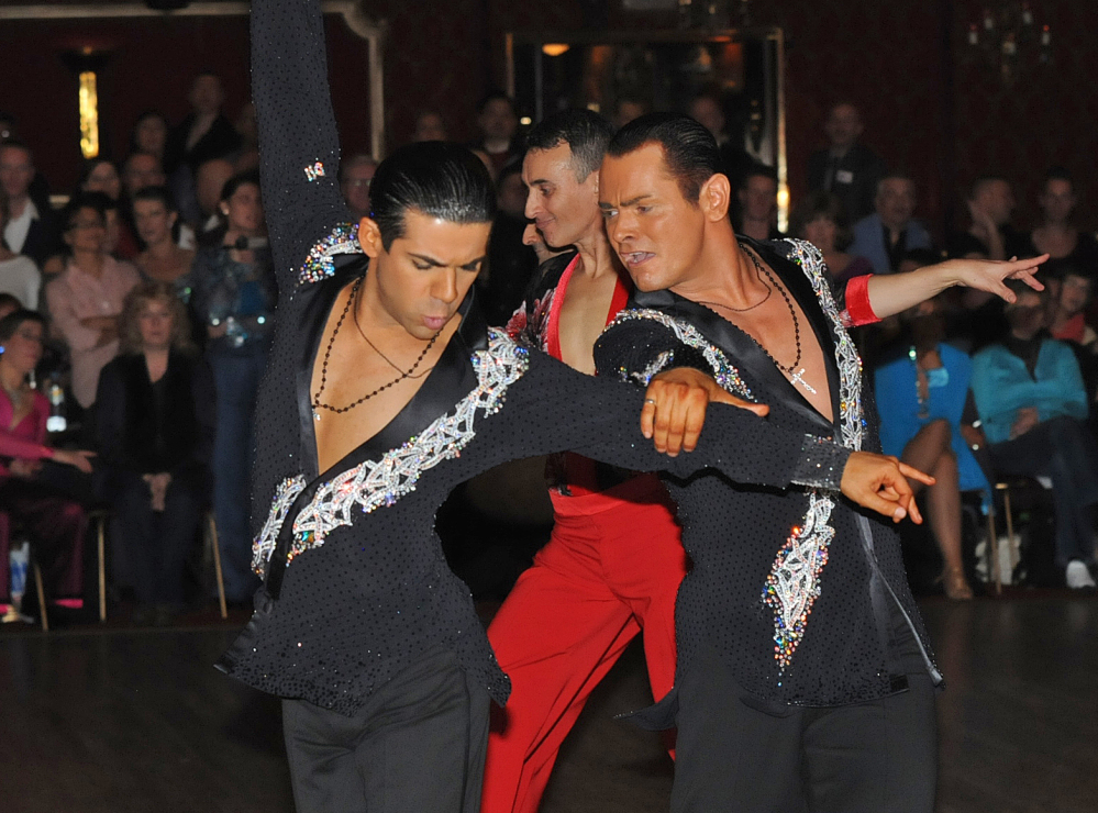 Sergio Brilhante, left, and Jonathan Morrison take part in a ballroom dancing competition. The governing body of ballroom dancing in Britain has stirred controversy by proposing to ban same-sex couples from competitions.