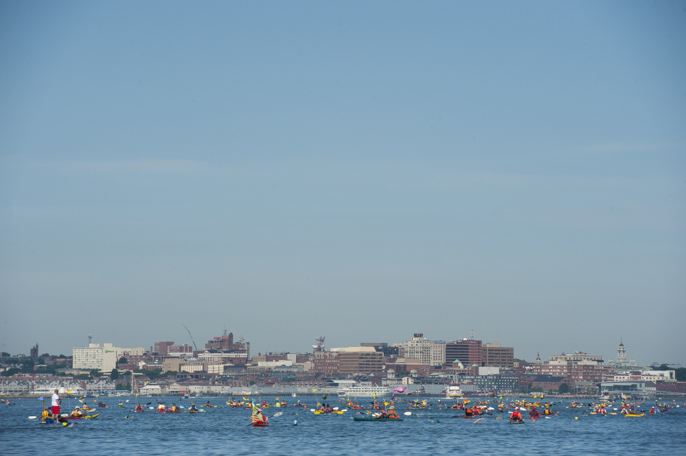 Swimmers and Kayaks navigate the course during the Peaks to Portland on Saturday.