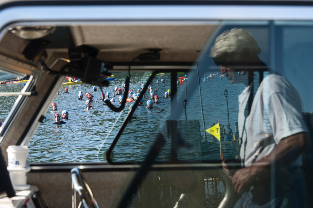 Swimmers prepare for the starting line during the Peaks to Portland on Saturday.